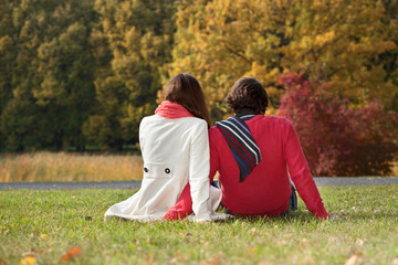 Couple sitting on the ground in the park