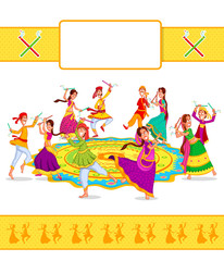 Couple performing Dandiya