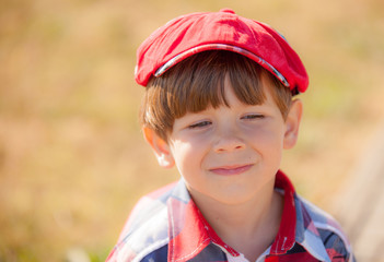 portrait of the boy in a cap