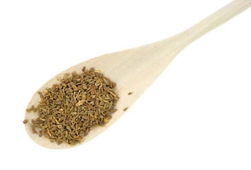 Anise seeds on wood spoon