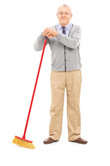 Senior man holding a broom