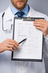 Doctor holding folder with form