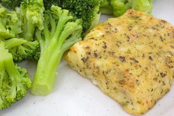 Baked Pollock with broccoli on plate