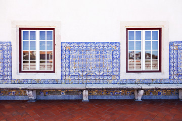 Wall with old Portuguese tiles and windows