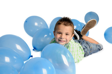 Blond boy with balloons on white background