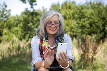 Mature woman with smart phone