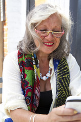 Mature woman unsing smart phone