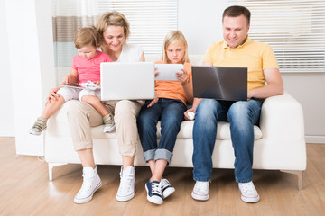 Family Using Tablets and Computers