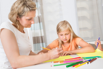Mother And Daughter Drawing Together