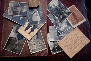 Old photos and letter on brown background.