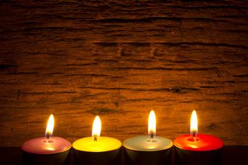 burning tea candle in night