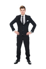 Portrait Of Confident Businessman With Hands On Hips