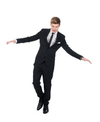 Businessman Balancing Over White Background