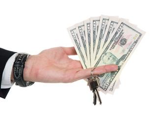 Businessman's Hand Holding Dollar Bills And Key