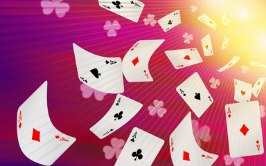 Playing cards falling on a pink background