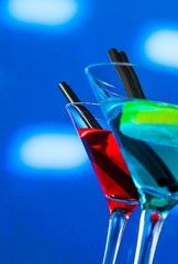 red and blue cocktail on light disco background