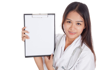 Young Asian female doctor show a blank clipboard