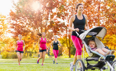 Mother and friends jogging