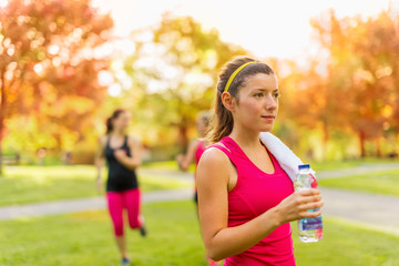 Healthy girl holding a water bottle
