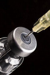 needle and injection in bottle on the glass