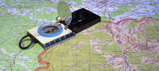 tourist's compass at travell map
