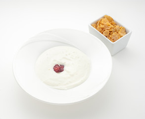 Plate of yogurt and oatmeal isolated on white