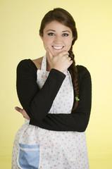 Smiling beautiful young hispanic brunette baker cook chef girl