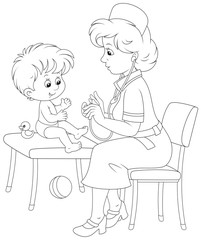Pediatrician examines a little child