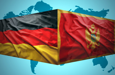 Waving Montenegrin and German flags