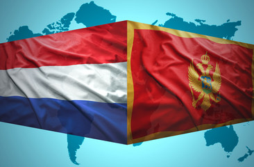 Waving Montenegrin and Dutch flags