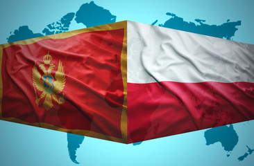 Waving Montenegrin and Polish flags