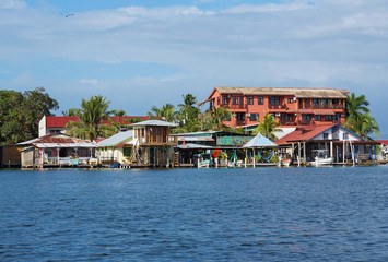 Houses over water with boats in Bocas del Toro