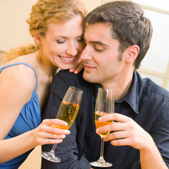 Cheerful couple with champagne