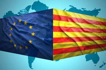 Waving Catalonia and European Union flags