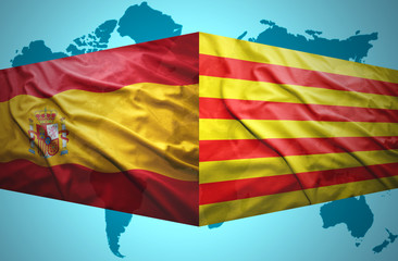 Waving Catalonia and Spanish flags