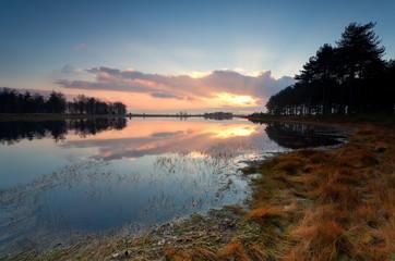 autumn sunset over wild lake