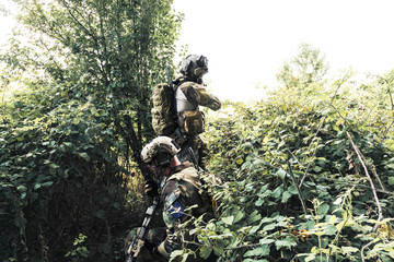 Soldiers in uniform of the U.S. Army in the woods