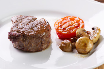 Meat with mushrooms and tomato