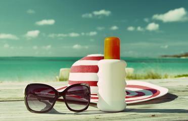 Hat, sunglasses and sun lotion. Exuma, Bahamas