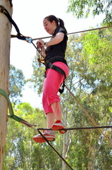 Teenager in a rope park