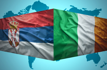 Waving Serbian and Irish flags