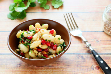 white beans in a salad with cilantro and pomegranate