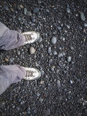 man walking on stones