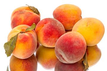 Tasty juicy peaches  on white