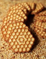 Honey cookies on chopped hazelnuts