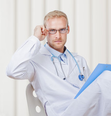 Portrait of a Young Doctor with Stethoscope and Glasses