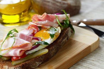 Bacon and fried eggs open sandwich