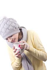 cheerful girl holding a Christmas mug with hot coffee