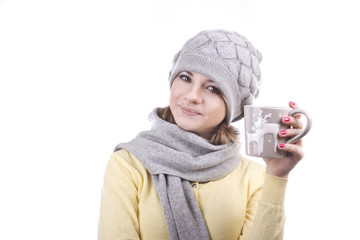 girl holding a Christmas mug with hot coffee on white background