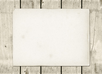 Blank vintage paper sheet on a white wood board